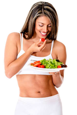 over eating: Woman dieting eating a vegetables salad - isolated over white  Stock Photo