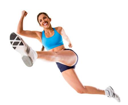 atleta corriendo: Salto de la mujer atleta - aislados en un fondo blanco