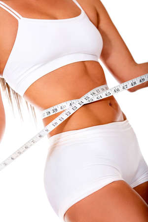 Healthy woman loosing weight - isolated over a white background  photo