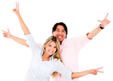 Excited couple celebrating with arms up - isolated over a white background  photo
