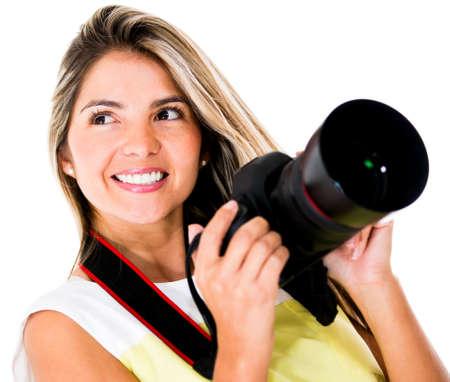 Female photographer holding a camera - isolated over white background  photo