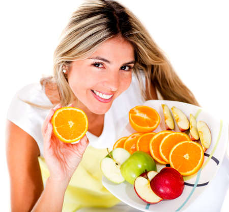 over eating: Healthy eating woman holding a tray of fruits - isolated over white