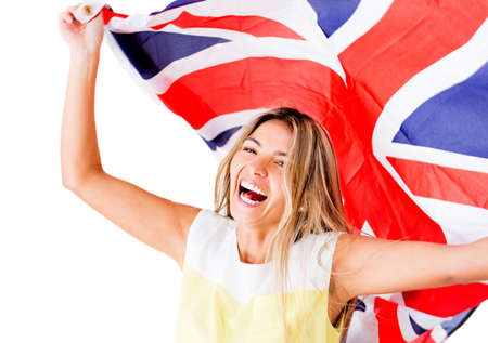 english girl: Happy woman laughing and holding the British flag - isolated over white