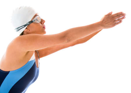 swimmers: Female swimmer diving - isolated over a white background