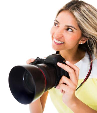 Female photographer holding digital camera - isolated over a white background  photo