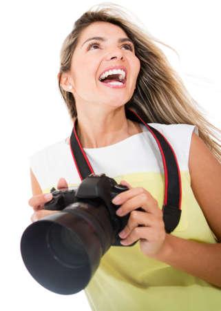Female tourist holding a digital camera - isolated over white background  photo