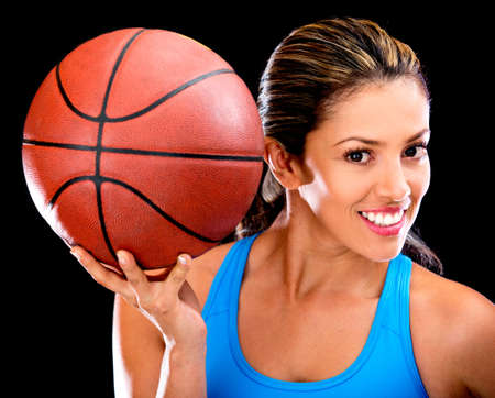 a basketball player: Female basketball player - isolated over a black background