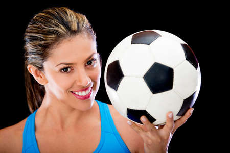 Woman holding a soccer ball - isolated over a black background photo