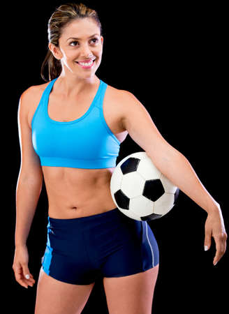 Female soccer player - isolated over a black background  Stock Photo - 14422450