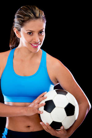 Woman holding a football ball - isolated over a black background photo