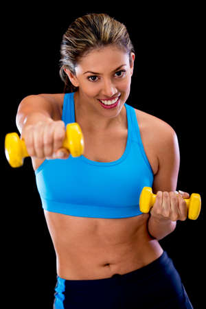 Woman exercising at the gym with free weights  photo
