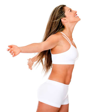 Happy fit woman enjoying her freedom - isolated over a white background photo