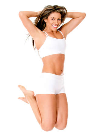 Happy woman jumping in her underwear - isolated over a white background  photo