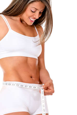 Fit woman taking measurements - isolated over a white background photo