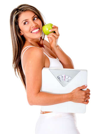 over weight: Healthy eating woman trying to lose weight - isolated over a white background  Stock Photo