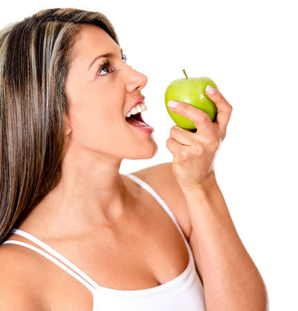 Woman eating healthy biting an apple - isolated over white background  photo
