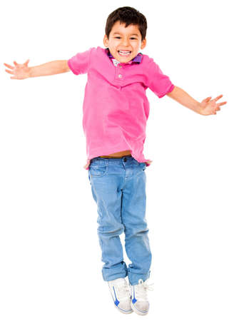 children jumping: Happy boy jumping - isolated over a white background