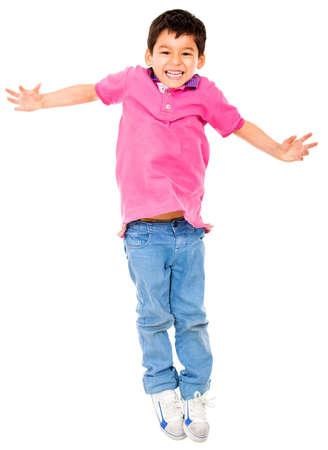 boy jumping: Salto de ni�o feliz - aislados en un fondo blanco Foto de archivo