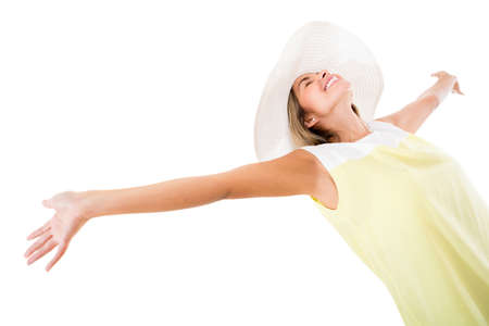 Woman enjoying her summer holidays - isolated over a white background  photo