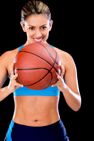 Female basketball player holding the ball and smiling  photo