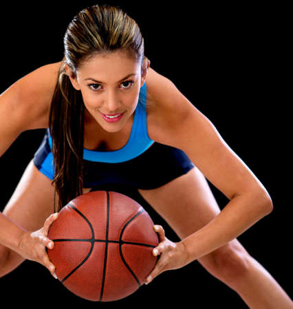 girl in sportswear: Competitive female basketball player holding the ball