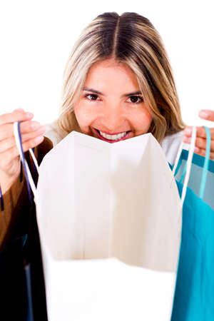 Happy shopping woman looking at her purchases in a bag  Stock Photo - 14529011