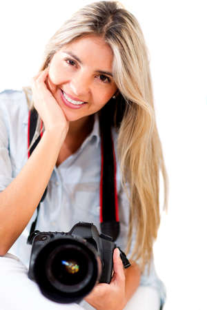 pics: Female photographer holding a camera - isolated over a white background