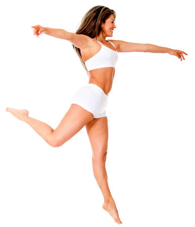 Happy woman jumping enjoying her freedom - isolated over a whie background  photo