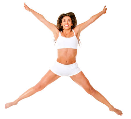 Fit woman jumping in her underwear - isolated over a white background  photo