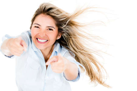 Happy woman pointing at the camera - isolated over a white background Stock Photo - 14469222