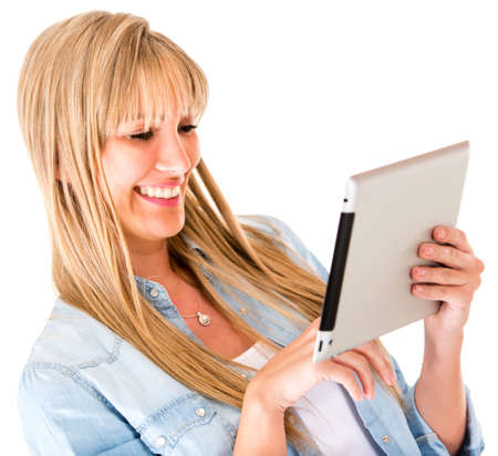 Woman using apps on a tablet computer - isolated over a white background  photo