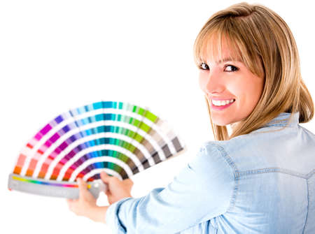 decorating: Woman choosing color to paint her house - isolated over a white background