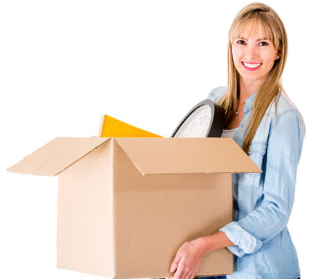 Woman moving house and carrying a box - isolated over white background photo