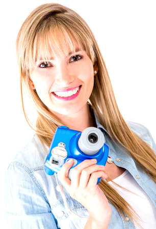 Woman holding snapshot camera - isolated over a white background  photo