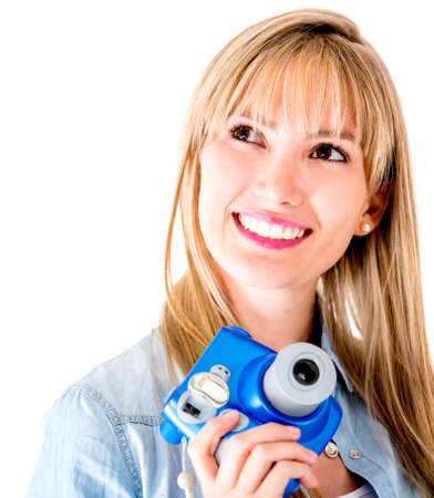 Female photographer with snapshot camera - isolated over a white background  photo