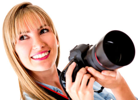 shoot: Beautiful female photographer holding a camera - isolated over white background