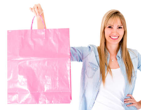 woman holding bag: Shopping woman holding bag - isolated over a white background