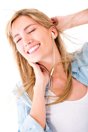 earbud: Woman relaxing and listening to music - isolated over a white background