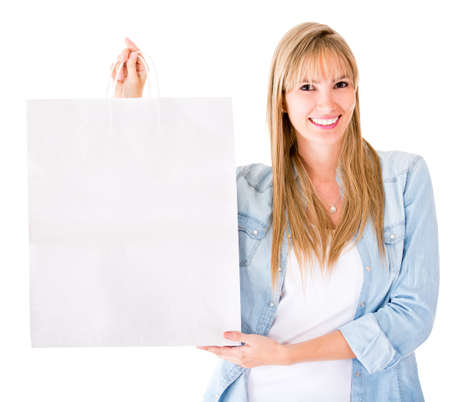 Woman holding a shopping bag - isolated over a white background  Stock Photo - 14507497