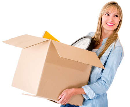 Woman packing and carrying a box - isolated over a white background photo