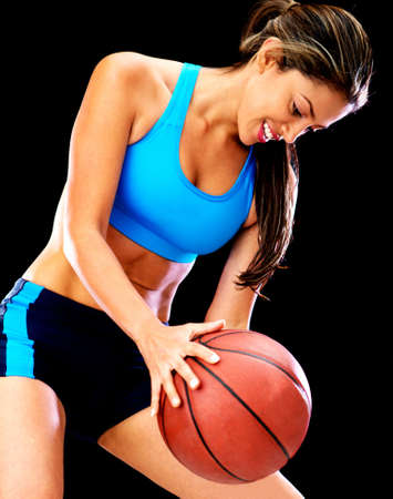 Woman playing basketball and holding the ball  photo
