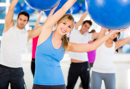 Group of people doing Pilates with a Swiss ball  photo