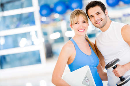 Fit couple at the gym looking very attractive  photo