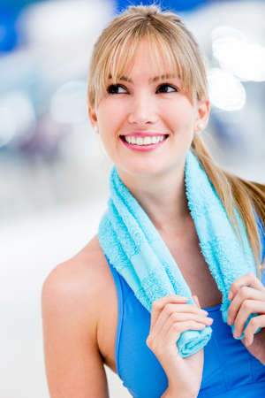 gym girl: Beautiful pensive woman at the gym smiling