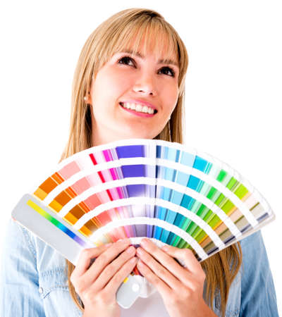 redecorating: Woman thinking of redecorating and choosing a color to paint