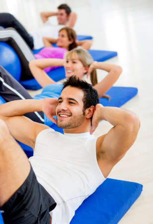 Group of people exercising at the gym  photo