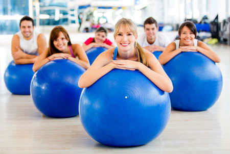 Group of people in a Pilates class at the gym  photo