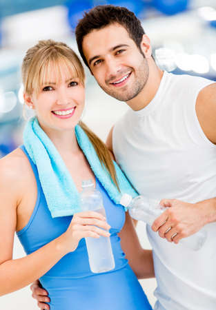 loss: Attractive couple at the gym looking happy Stock Photo