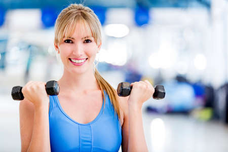 free weight: Fit woman at the gym lifting weights