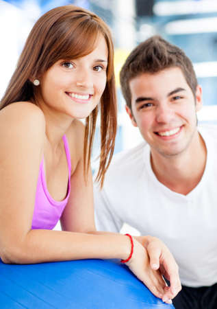 Beautiful couple at the gym looking happy  photo